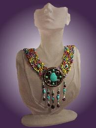 Fiber Crochet Turquoise Necklace - A special order from Cleopatra, and also Nefertiti wants it too! Handcrafted crochet with fibers. Metal Silver medallion. Chinese, Kingman, Sleeping Beauty Turquoise and A Grade Amethyst. Sterling Silver findings and clasp. Limited production.