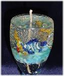 Medium Size Gel Candle- Lt. Blue glass goblets. Gel wax and glass fish are used to embellish the gel candle. Dry flowers sticks are used to create the coral atmosphere. Zinc-cored wick for great and secure burning process. Unique designs!  All fragrances available! Specify the fragrance with your order. Thank you.