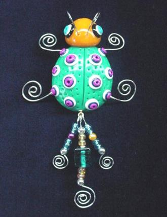 Handmade with glazed Fimo. Silver plated  wire and glass beads are used for final details.
