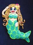 Fimo Mermaid Pin- Handmade with glazed Fimo. Silver plated  pin bar is used for final details.