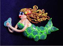 Mermaid in Motion Pin- Handmade with polymer clay. Austrian Crystals are use for final details. It can be created in different colors. Specify w/order. Unique and different.