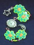 Fimo Green Flower Watch-  Handmade with glazed Fimo. Silver plated  wire, findings and clasps are used for final details. Glass beads are used to embellish the Fimo Green Flowers.